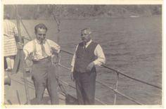 """Vapor Enco en el lago Riñihue  Luis Núñez, conocido como """"Conductor Núñez"""" por su trabajo como maquinista de ferrocarriles, junto al capitán de la embarcación, mientras navegan por las aguas del lago Riñihue. El vapor Enco fue el medio de transporte de la comuna de Los Lagos durante las décadas de 1920 y 1940, luego fue trasladado al lago Panguipulli, para ser utilizado hasta la década de 1980 en el transporte de pasajeros y de lanchones madereros entre Choshuenco y Panguipulli.  Año 1930."""