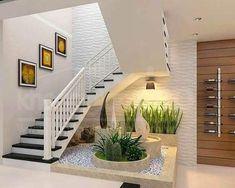 Jardim de inverno embaixo da escada: vasos grandes e esculturas transforma espaço #jardimembaixodaescada #jardimembaixodaescadapequeno #jardimembaixodaescadainterna