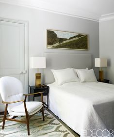 The master bedroom of Paris fashion star Andrew Gn's Right Bank apartment features a 1950s Swedish rug. Custom-made nightstands by Benoit Langlade, topped with 1970s lamps, flank the bed, the coverlet is by Le Rideau de Paris, and the armchair is Danish.