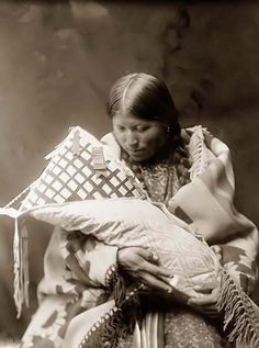 You are viewing a touching image of a Cheyenne Mother and Child. It was taken in 1905 by Edward S. Curtis.    The image shows a wonderful view of this woman gazing at her infant child.    We have created this collection of images primarily to serve as an easy to access educational tool. Contact curator@old-picture.com.