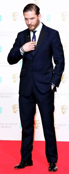 The British actor Tom Hardy attended the British Academy Film Awards (BAFTAs) in London on February 16th, 2014 in an Alfred Dunhill midnight blue mohair tuxedo.