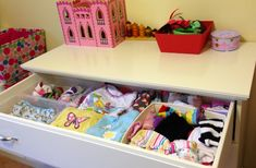 Organize dresser drawers by separating items into plastic bins or shoe boxes