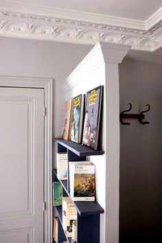 For homes where the front door leads right into the living room, add a small divider wall to break up the space. Great idea! #homedecor #entryway #livingroom