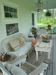 Love the vintage, eclectic look of theis mostly white porch!