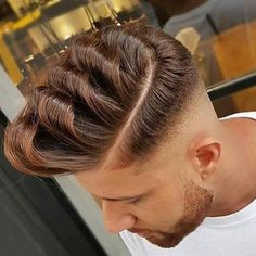 Pompadour Fade Haircut Guide  The Pompadour is a hairstyle that was first named after Madame de Pompadour, the mistress of King Louis XV. Since then, it remained a haircut for women until Elvis Presley made the world pay attention to the hairstyle. A pompadour fade haircut features short sides and hair combed upwards into a pomp, and to the back. It is a combination of the classic pompadour with a fade. Some people may choose to add a sideburn to the pompadour for an old-school rockabilly…