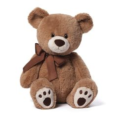 """GUND is proud to present Kiwi — a tan bear with a cute little corduroy nose! Features a classic design and paw pad accents, while a bow provides some chic appeal. This 17"""" size is perfect for cuddling"""