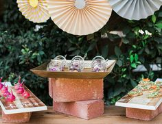 Industrial take on a foo display // Layered red bricks with textured copper trays and wood palates for serving trays for appetizers // summertime inspiration // backyard party