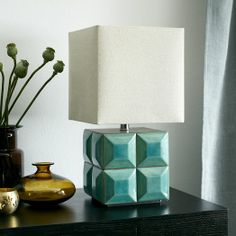Created in collaboration with British designer Lubna Chowdhary, the tiles on this lamp are hand-painted in a reactive glaze, which creates a vintage, textured look.