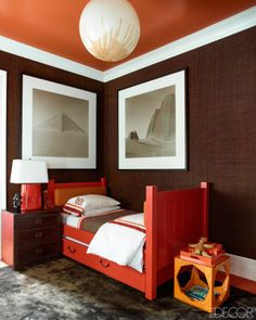 Bold shades of orange & red in a boys bedroom // NYC apt, by Steven Gambrel
