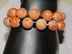 Pair of Large Orange Black Swirl Glass Beads by NammersCrafts