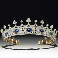 @boylerpf. The tiara designed by Prince Albert for Queen Victoria. She is seen wearing it in the painting by Winterhalter of 1842 and wore it on her first public appearance after Albert's death, recording the event in her diary. It is set with diamonds and sapphires.