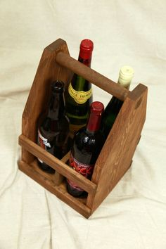 22oz Bomber Beer Wine and Liquor Caddy by ReImagineUpCycling - My husband asked for one of these for Christmas. There are a lot of carriers I've found for six packs, but this is the first I've seen for bombers. You can even add a bottle opener and initials!