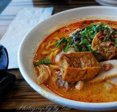 Traditional Malaysian curry laksa. Had one for lunch at the local restaurant Laksa King. Natural light source from the window at the right.  while I'm enjoying taking photos of food, it's really difficult to do it in restaurant without looking like an idiot.