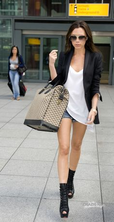 Victoria Beckham with a #Goyard overnight bag.