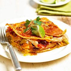 Layered Turkey Enchiladas - This simple supper features a zippy cranberry enchilada sauce, chicken or turkey, a medley of veggies, and lots of cheese.