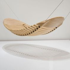 The Wooden Hammock was designed as an alternative to the common cloth hammock. Although made from wood, the design is flexible and comfortable due to rubber vertebra which allow the wooden segments to move, mimicking the human spine.