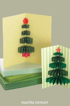 As this card opens, a tree made from pleated paper rectangles pops out, like a small gift. Although it can be glued into any size greeting, it is especially attractive in a tall, slender card that mimics a pine tree's natural dimensions. #marthastewart #christmas #diychristmas #diy #diycrafts #crafts