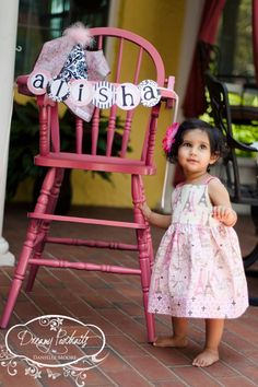 pink high chair - for first birthday photo
