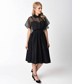 Luna makes it hard not to stare, gals! A stunning swing dress from Unique Vintage, The Luna Dress is cast in a marvelous black brushed cotton for a luminous 1940s style. The sweetheart bodice features princess seams and a banded waist with pointed empire