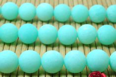 37 pcs of Green Jade matte round beads in 10mm