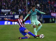Atletico Madrid's Croatian defender Sime Vrsaljko (L) vies with Barcelona's Brazilian forward Neymar during the Spanish Copa del Rey (King's Cup) semi final first leg football match Club Atletico de Madrid vs FC Barcelona at the Vicente Calderon stadium in Madrid on February 1, 2017. / AFP / PIERRE-PHILIPPE MARCOU