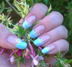 Base is Beverley Hills Plum by Orly topped with original Pearl Shine by Avon. The tips are Serrano by The Edge. The flowers were purchased from EBay