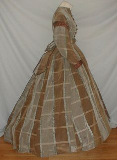 Civil War 1860's Brown Gray Silk Dress Study or Pattern   eBay A classic 1860's Civil War era brown and gray plaid silk dress. Sleeves are trimmed with pleated brown satin.  Bodice is lined with cotton and has a front button closure. Dress has an attached center back peplum belt that has a large bow and long streamers. Skirt has a back train and is fully lined with cotton. Bust 34 Waist 24 Skirt front length 38 Back length 47 Width at hemline 142.