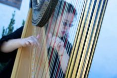 A beautiful harpist sets the mood for the ceremony