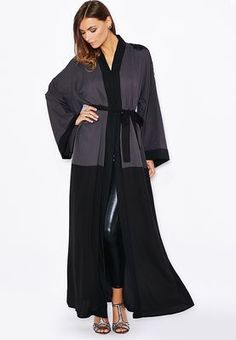 We love the minimalistic design and simple style of this embellished abaya by Haya's Closet. Shop for it now on www.namshi.com