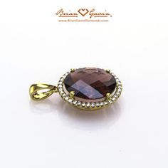 Garnet and gold is always a good idea. This Brian Gavin Diamonds 18k yellow gold pronged pendant features a 12x10mm oval checkerboard garnet center stone (approx. 3.98 ct.) Accented with approx. 0.12 ctw diamonds.