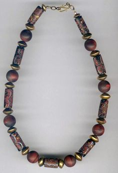 by African Trade Beads | Necklace; Matching antique Venetian Millefiore glass cylinders, combined with Red Tiger Eye stones and gold plated bicone spacers | 110£ ~ sold