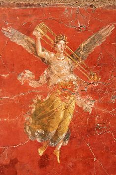 Winged victory. Ancient Roman frescos from Pompeii in the 4th Pompeian style, Italy, 64 BC.