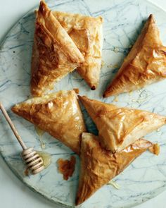 Honey-Ricotta Turnovers = Prepare & freeze up to a month ahead of time & then pop them in the oven as your guests arrive
