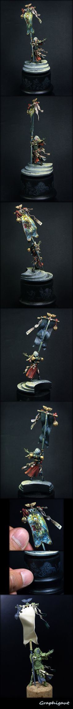 Look! A non-sexualized female miniature! I really like GW's Sisters of Battle range, and I dearly wish they'd expand it.