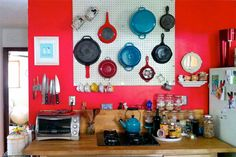 A pegboard in the kitchen can help you clear out some cabinets and increase storage space. #springcleaning