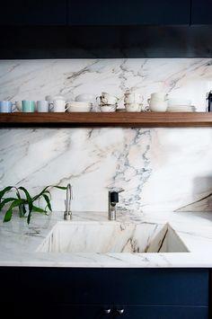 KITCHEN DETAIL:  Marble and dark blue cabinetry | Image via Ensemble Architecture, DPC