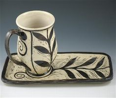 A new world take on the classic tea cup and saucer.... Renee Schwaller's Off The Wheel Pottery.... He sgraffito technique is brilliant.