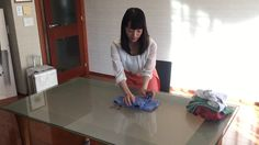 Marie Kondo, the decluttering guru, shows how to fold a T-shirt perfectly so that it stands up in your drawer.
