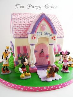 Mickey & Minnie Pet Shop cake. That is so cute. Please check out my website thanks. www.photopix.co.nz