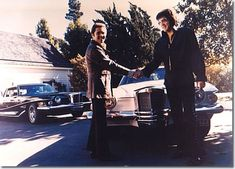 Elvis Presley accepting keys for his Pearl White Stutz Blackhawk from salesman Jules Meyers in late September / early October 1973