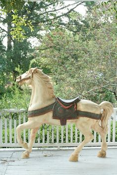 carousel horse on the porch - how perfect would this be?