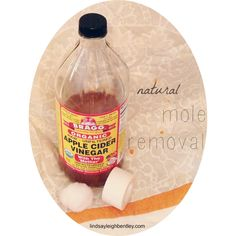 Read her personal story about removing her own moles in less than 2 weeks for less than 25cents a mole with just medical tape, cotton balls, and natural cider vinegar.