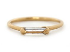 // Caged Lrg single Baguette halo ring front view 18Y