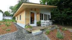 Great shot of the front of the tiny house, complete with our eco friendly furniture made from recycled plastic lumber.