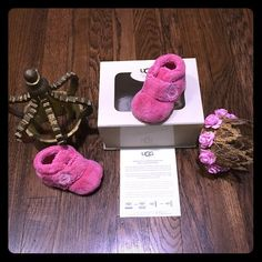 """Uggs Australia Infant BIXBEE shoes DETAILS The precious Bixbee is crafted from soft terry cloth to keep little feet cozy. The outsole features a silicone tread to help with baby's first steps, and a hook-and-loop closure takes some of the fuss out of getting dressed.  Details:  Terry cloth Hook-and-loop closure Synthetic suede outsole Silicone tread 2 ½"""" shaft height Excellent condition worn twice non walker. Adorable hott pink. Infant 0-1 0-6 months UGG Other"""