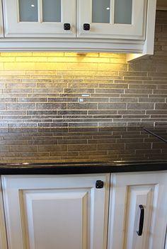 Black Galaxy Granite Countertop With Glass Backsplash & Under Cabinet LED Lighting