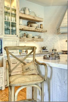 love the rustic chair, the shelves and the old silver tray holding the spices