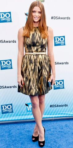 Ashley Greene WHAT SHE WORE Greene hit the Do Something Awards in a glittering ikat Michael Kors dress accented with a chunky Isharya cocktail ring, black and gold Roger Vivier minaudiere and black peep-toes.