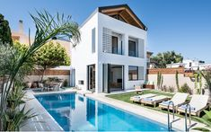Entire home/apt in Galatas, Greece. Gather with friends and family at this stunning villa with a private heated pool smartly fitted with contemporary furnishings, vibrant strokes of c. Chania Greece, Location Airbnb, Things To Do Nearby, Appartement Design, Station Balnéaire, Heated Pool, Main Entrance, New Homes, Vacation