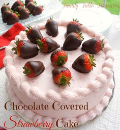 Chocolate Covered Strawberry {Cake} - Family Table Treasures Do you dream about chocolate? One taste of this Chocolate Covered Strawberry {Cake} and you will! The deepest, darkest, richest, most delicious chocolate cake you will ever taste! Filled with chocolate ganache and topped with strawberry cream cheese frosting (made from fresh strawberries). The final touch for this decadent dessert is to decorate it with chocolate dipped strawberries. Then watch it disappear!